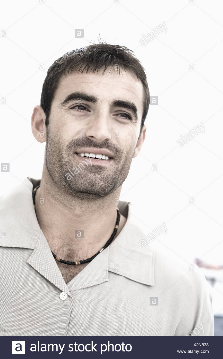 Close-up of a mid adult man smiling - Stock Image
