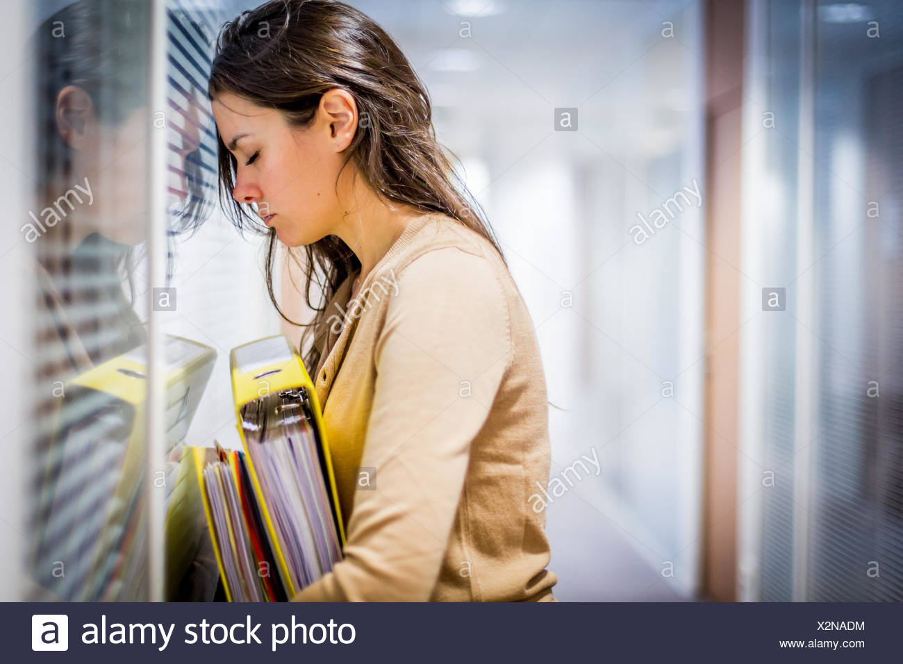 Tired woman at work. - Stock Image