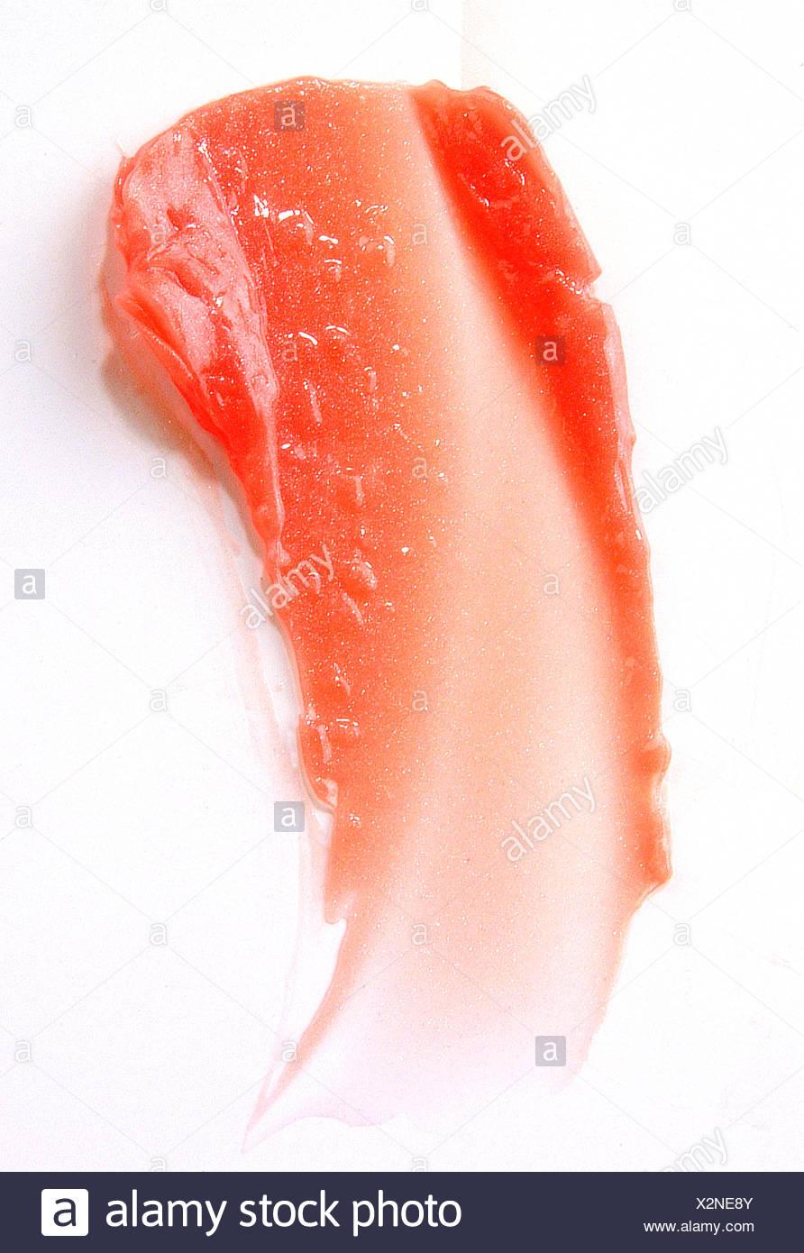 Smudge of orange lipgloss - Stock Image