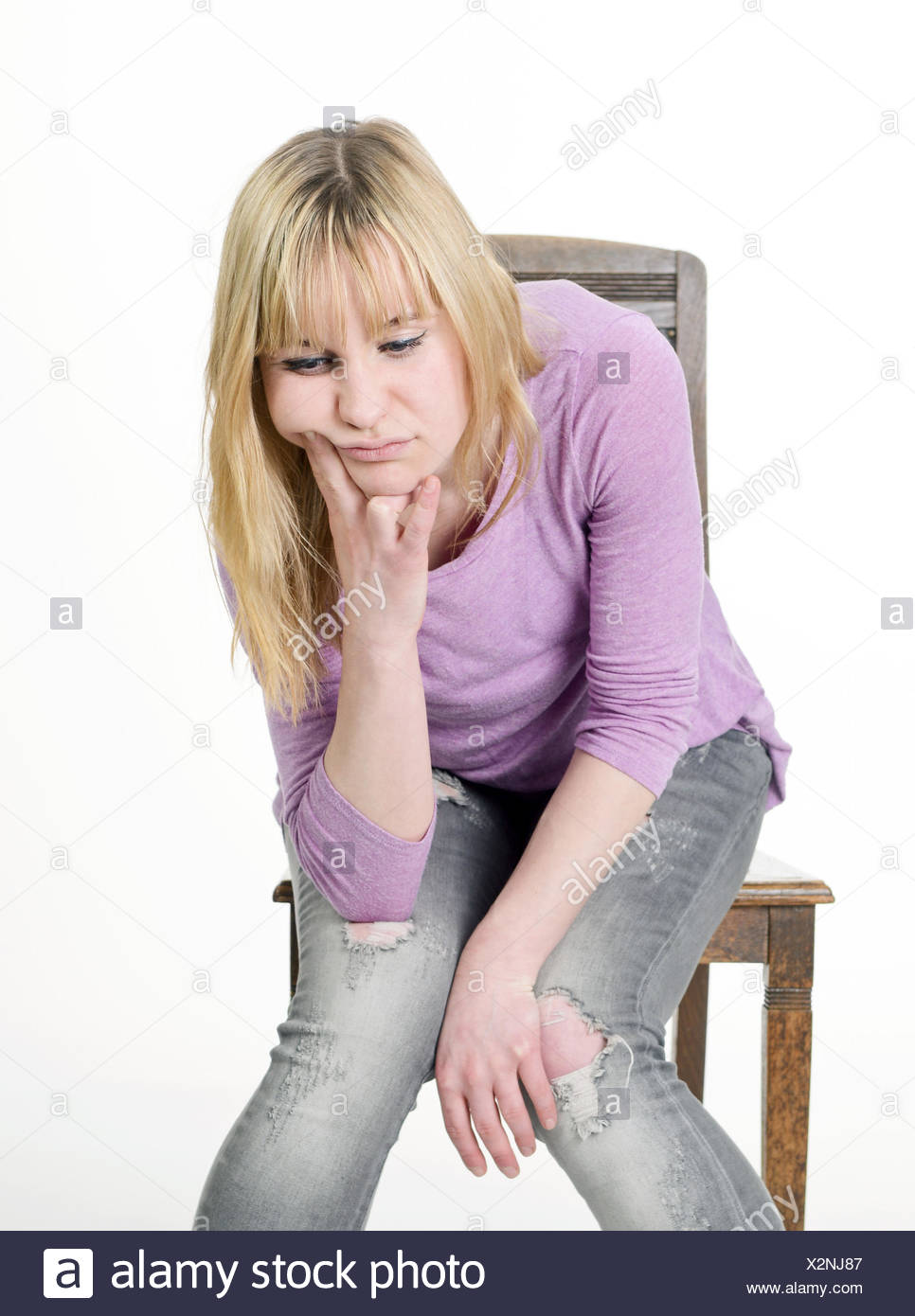 unhappy young woman - Stock Image