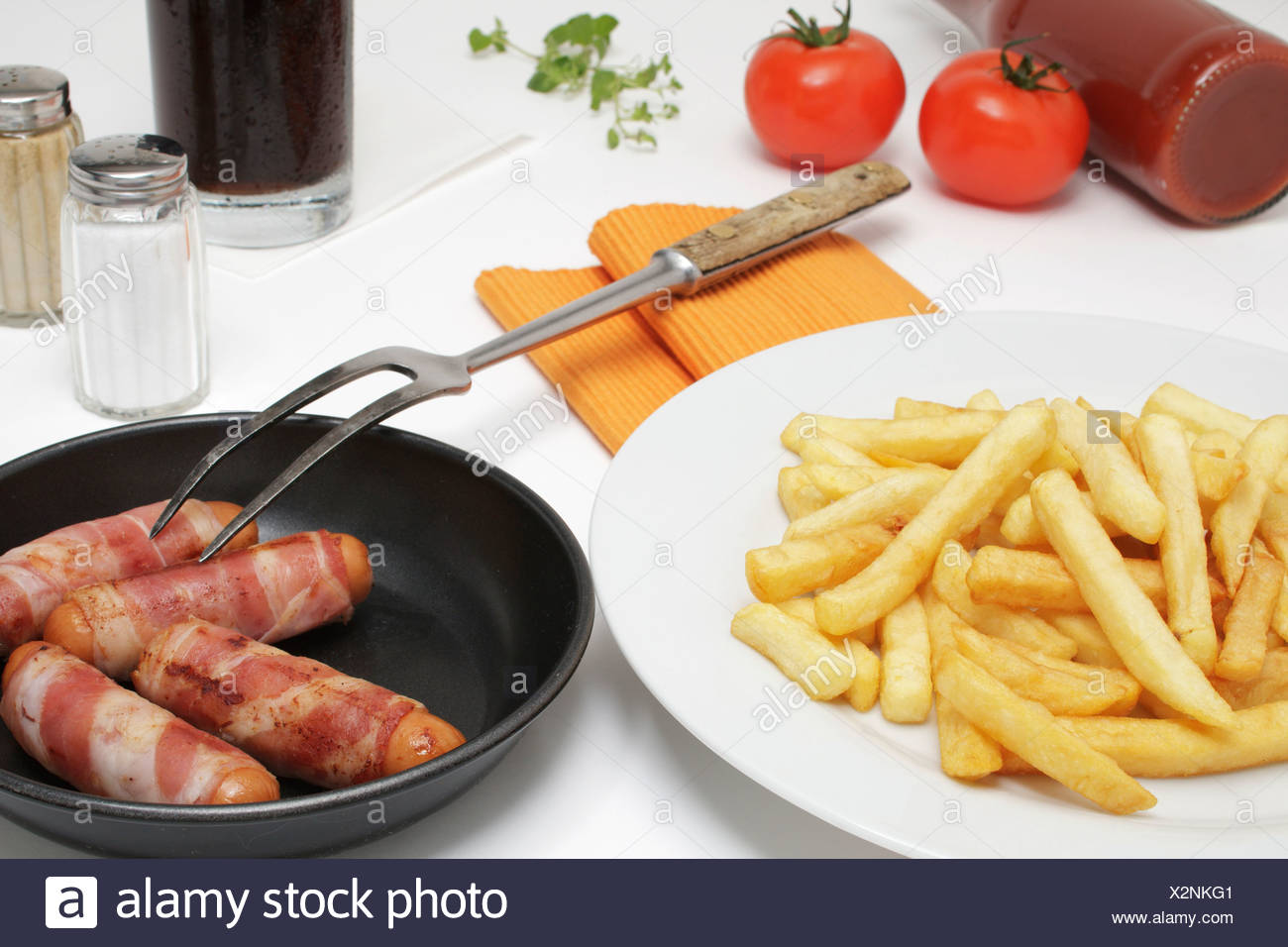 Bernese sausage with french fries, ketchup and Coke - Stock Image