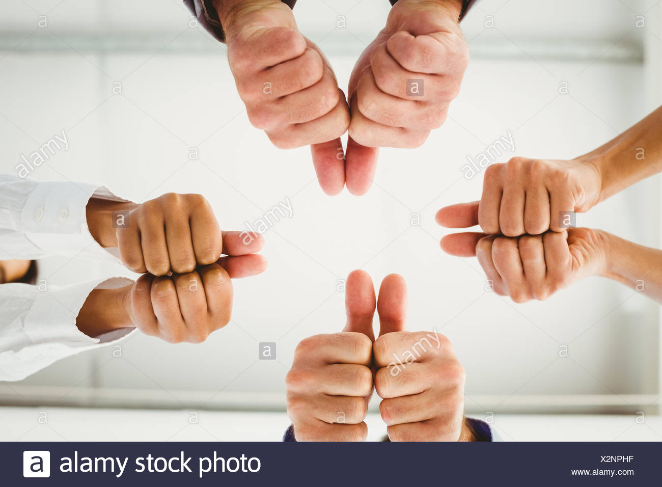 Multiple hands giving thumbs up - Stock Image