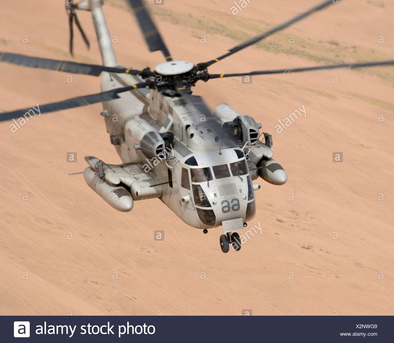 US Marine CH-53D Sea Stallion Helicopter Plies the Air Above the Desert in Iraq's Al Anbar Province - Stock Image