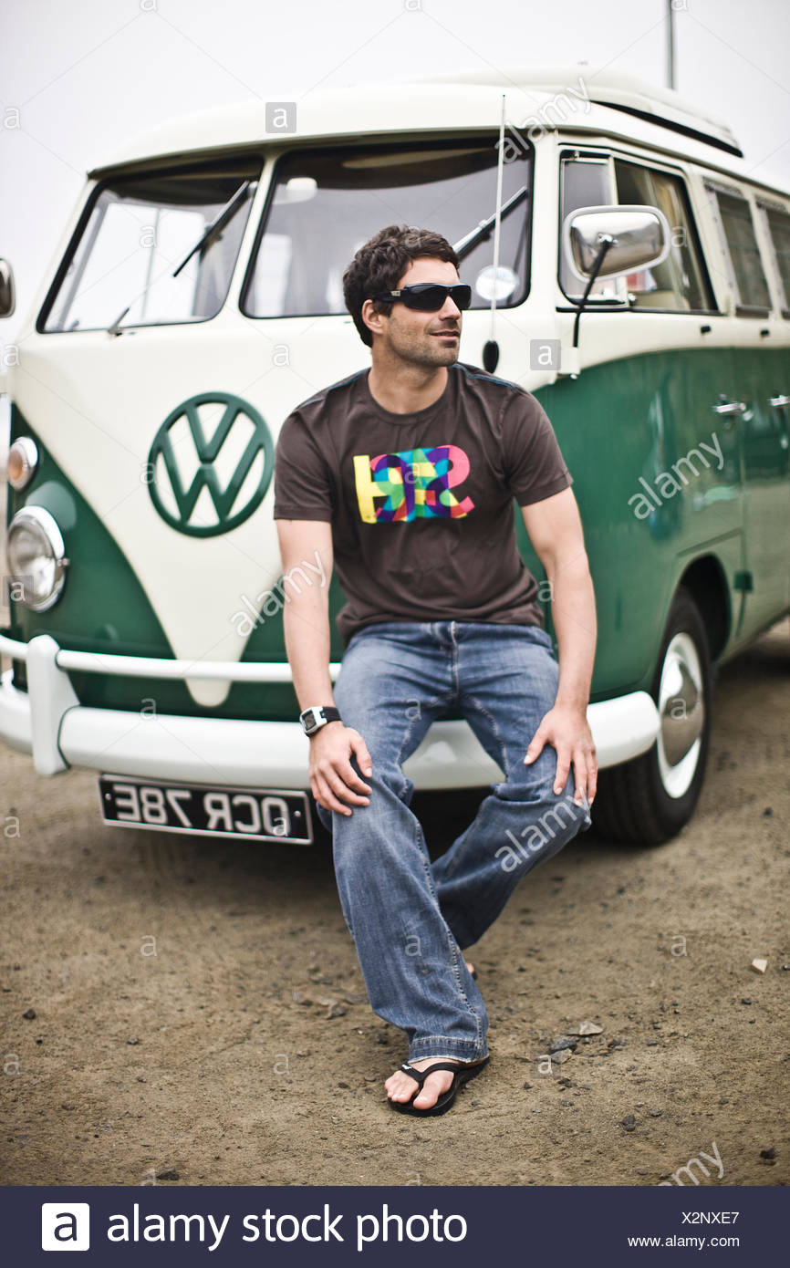 Surfer with VW campervan, St Agnes, Cornwall, UK - Stock Image