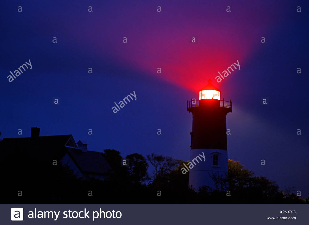 Nauset Light shines during a stormy night Cape Cod National Seashore Eastham Cape Cod MA USA - Stock Image