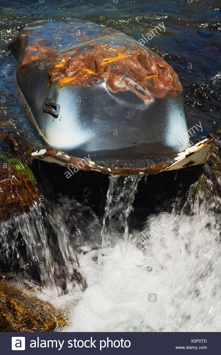 Old bath tub, 'disposed of' in a mountain river near Ordino, Principality of Andorra, - Stock Image