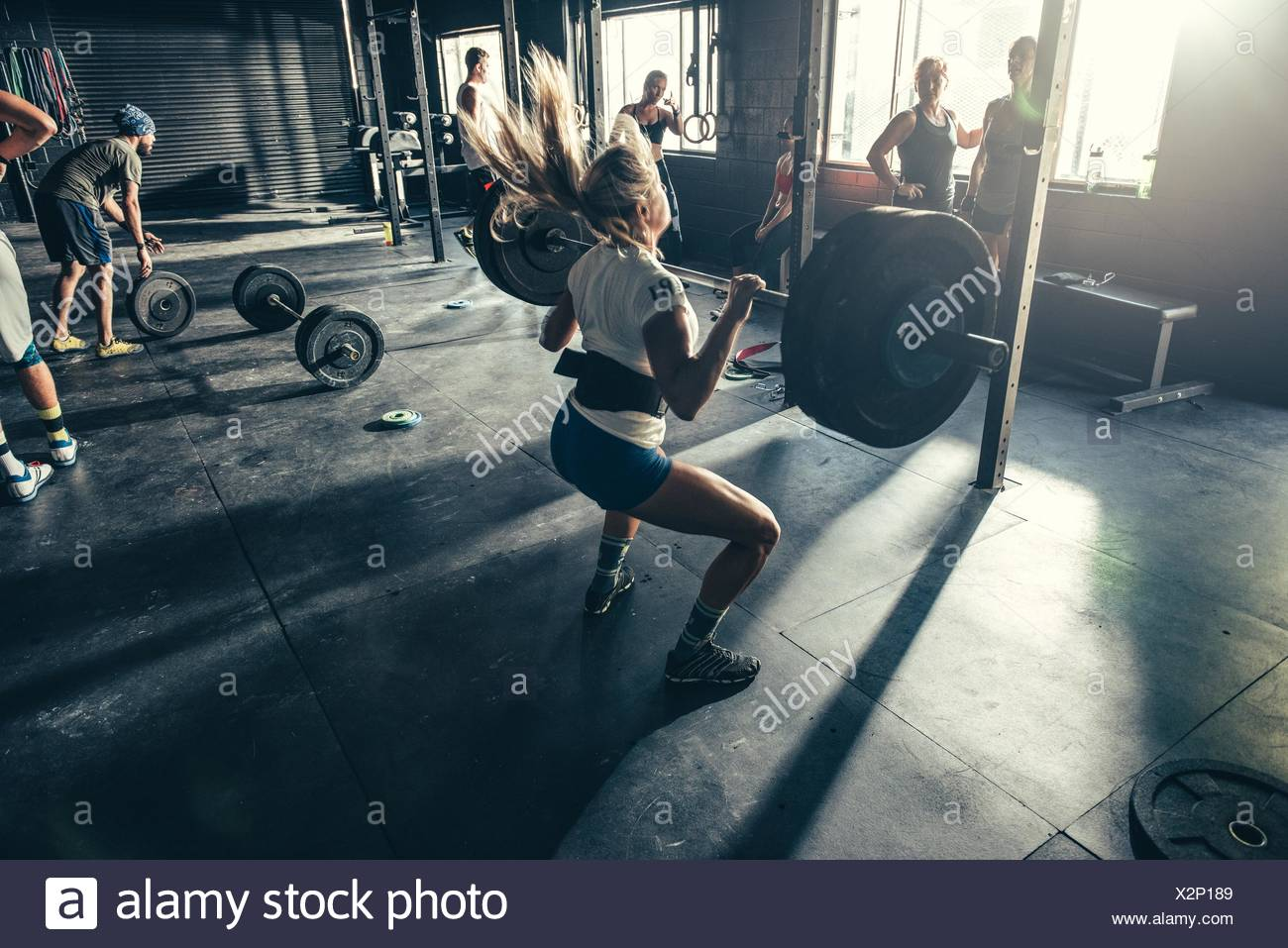 Woman training with barbell in gymStock Photo