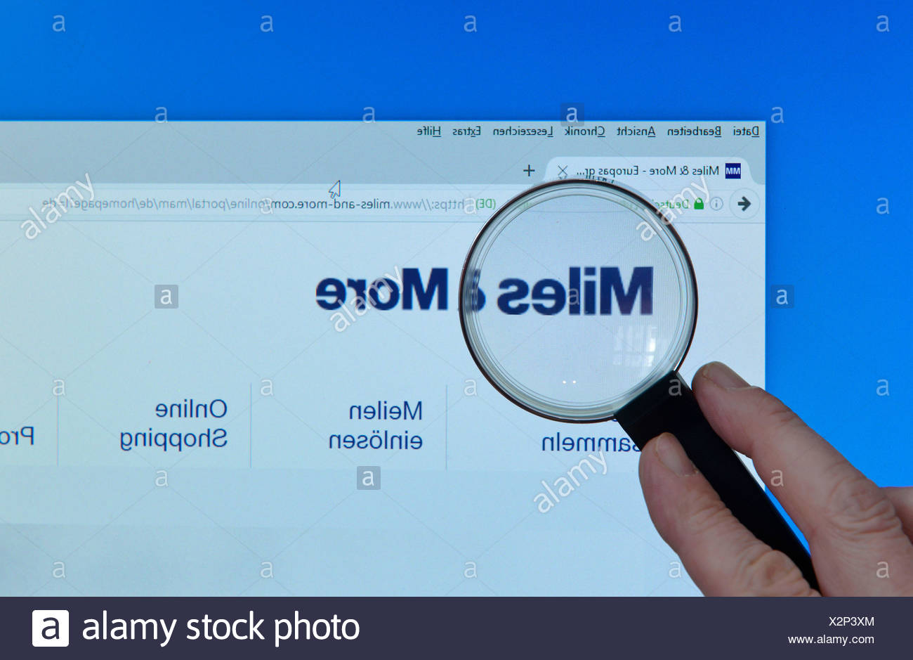 Miles-and-more.com, Internet, Monitor, Hand, Lupe - Stock Image