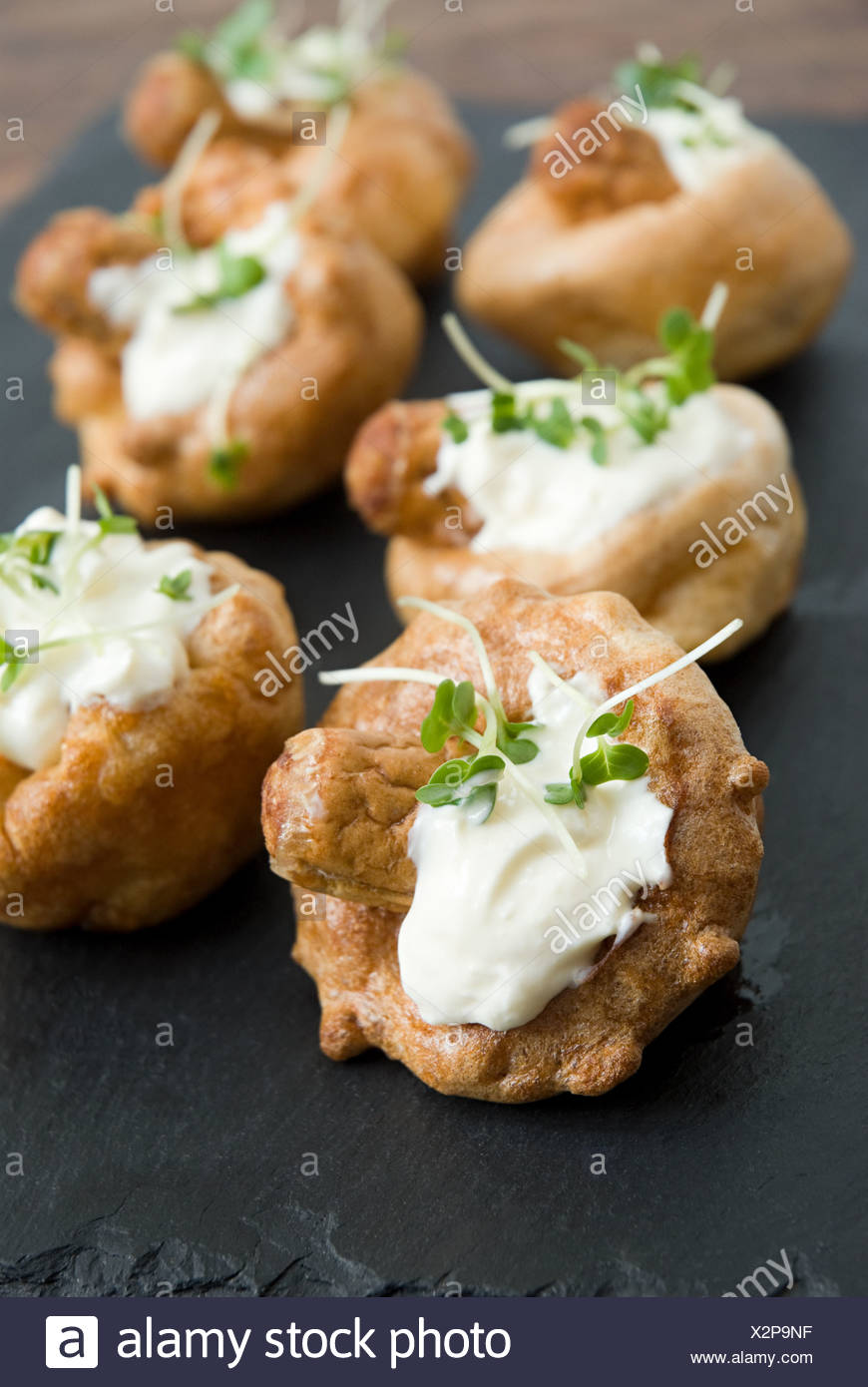 Miniature toad in the hole canapes - Stock Image