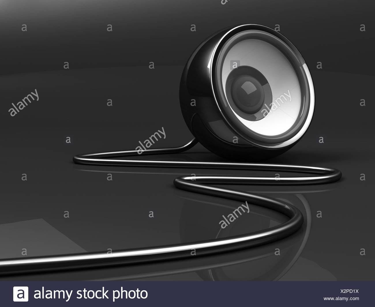 black speaker with cable over grey background - Stock Image