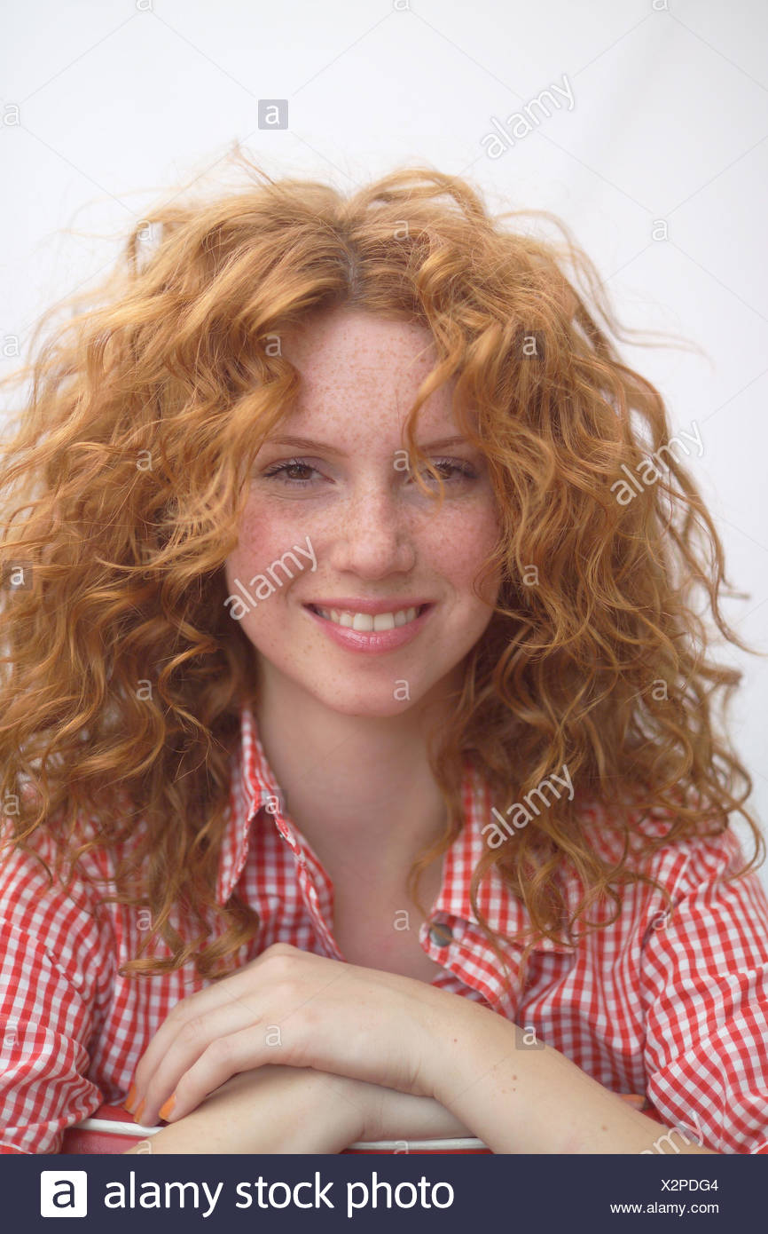 Woman, smile, red-haired, curls, portrait, redheads, young, course, naturalness, happy, calmly, calmness, self-confidence, self-confidently, openly, openly, nicely, women's portrait - Stock Image