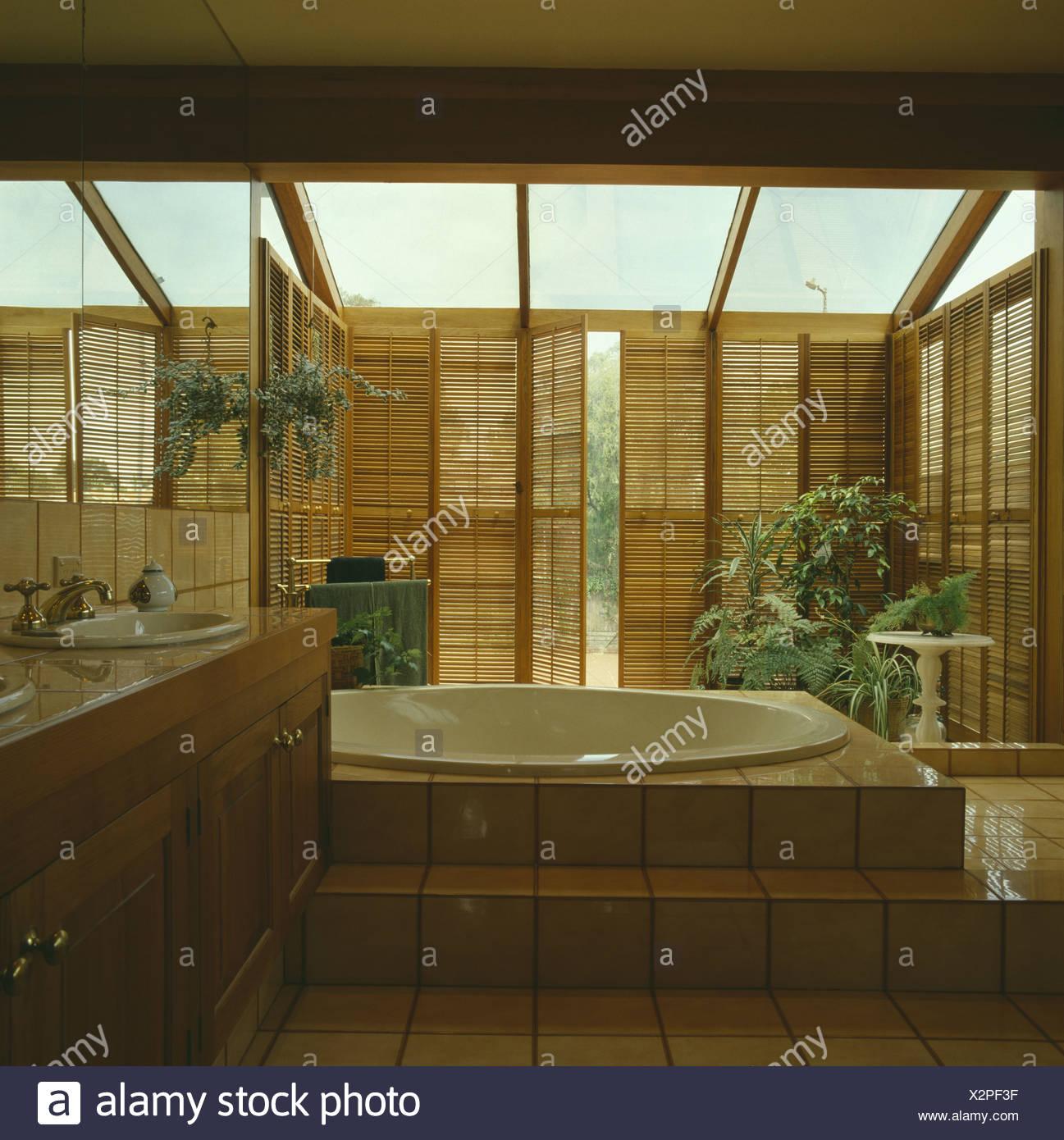 Raised Circular Bath In Modern Bathroom Extension With
