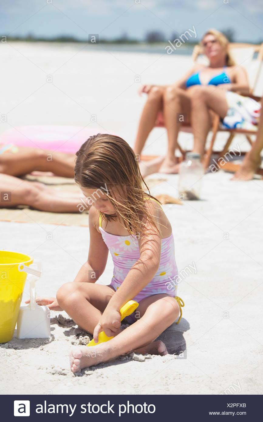 Family vacationing at beach Stock Photo