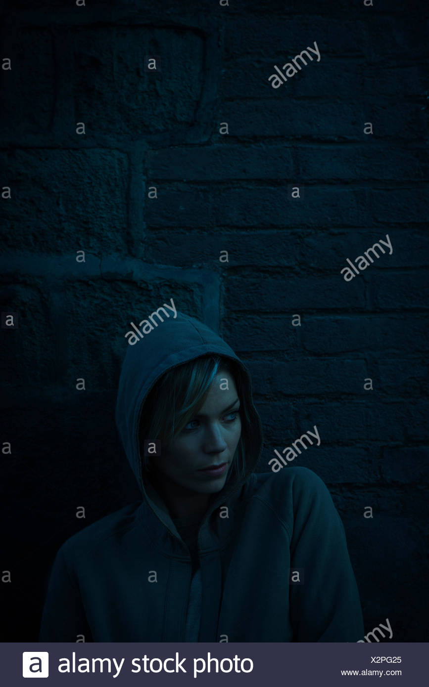 Woman wearing hooded sweatshirt on cold day - Stock Image