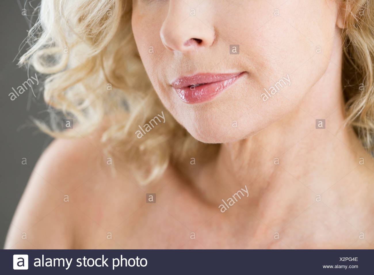 The lower face of a middle aged woman - Stock Image