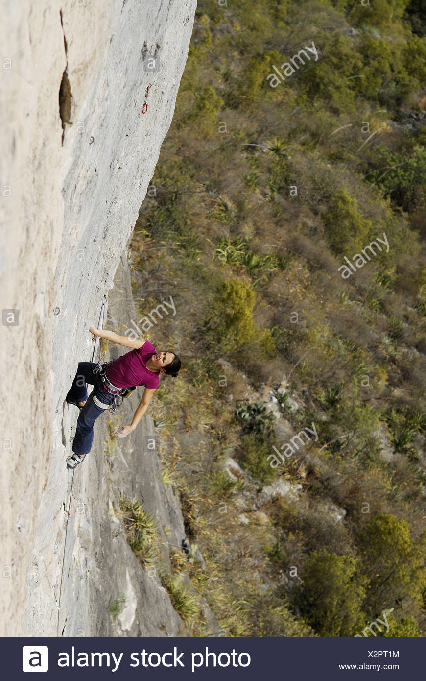 A rock climber ascends a steep rock face in Mexico. Stock Photo