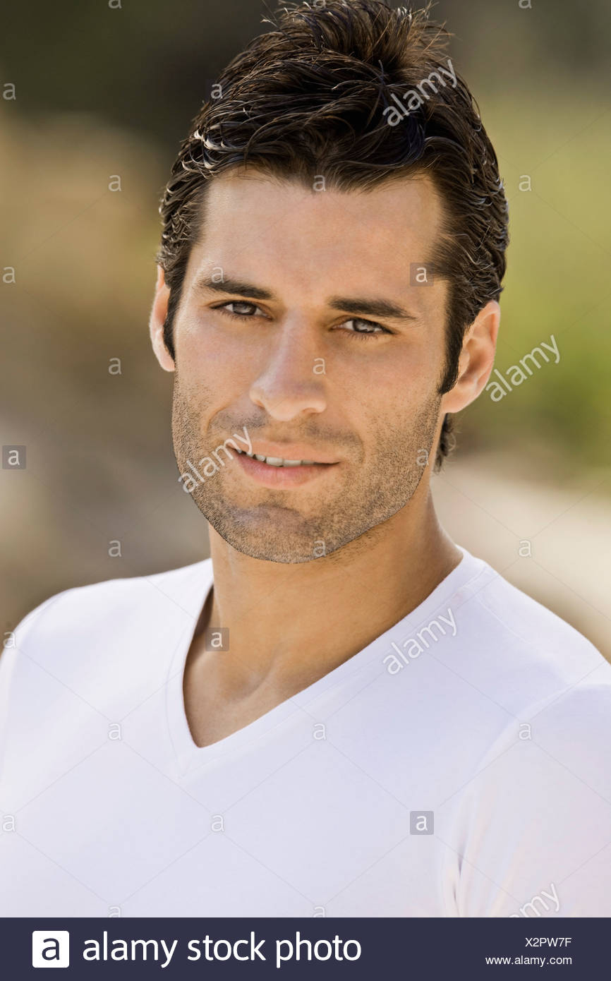 A latin male looking to the camera - Stock Image