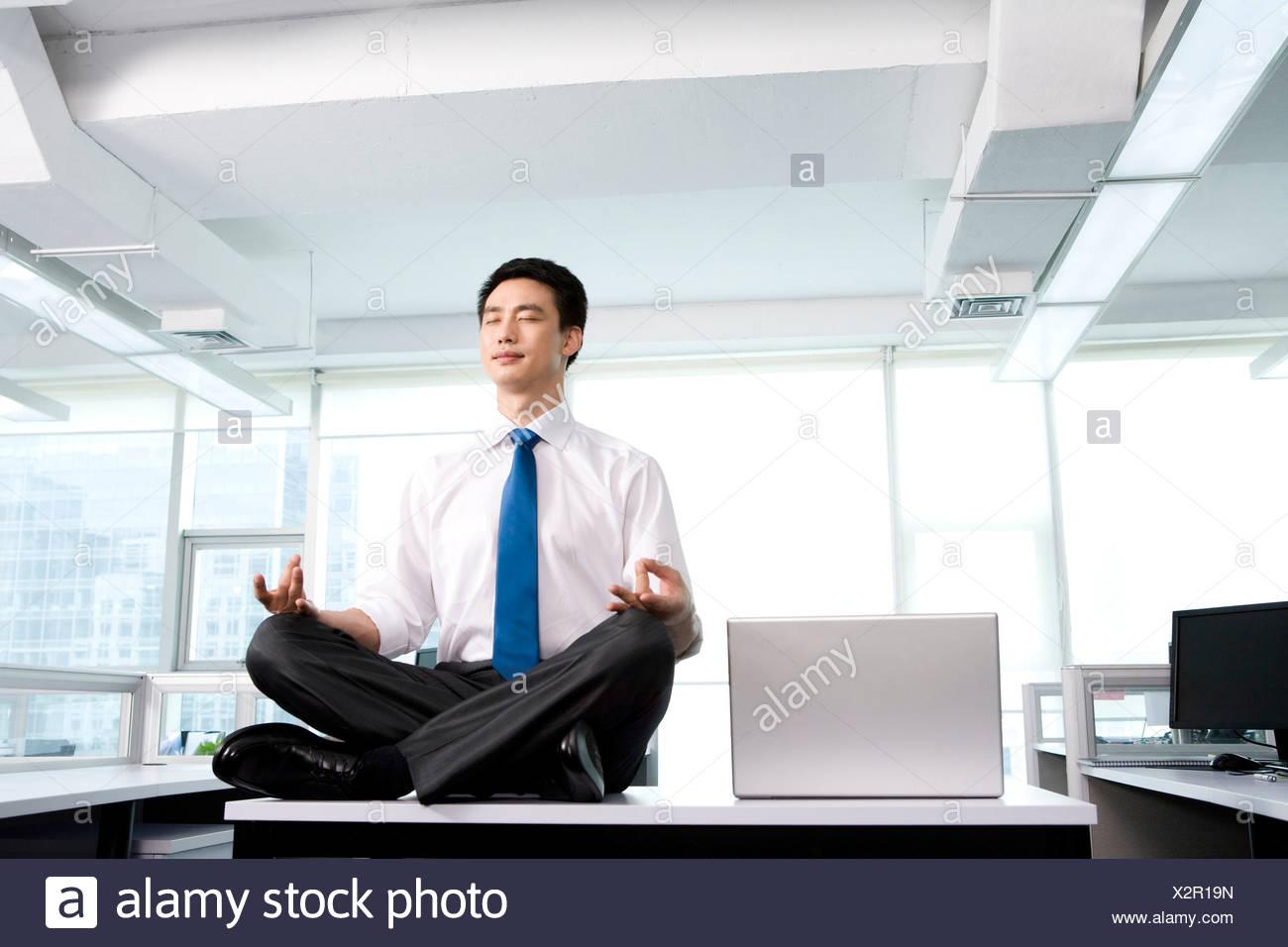 meditation businessman office. Meditation In The Office - Stock Image Businessman