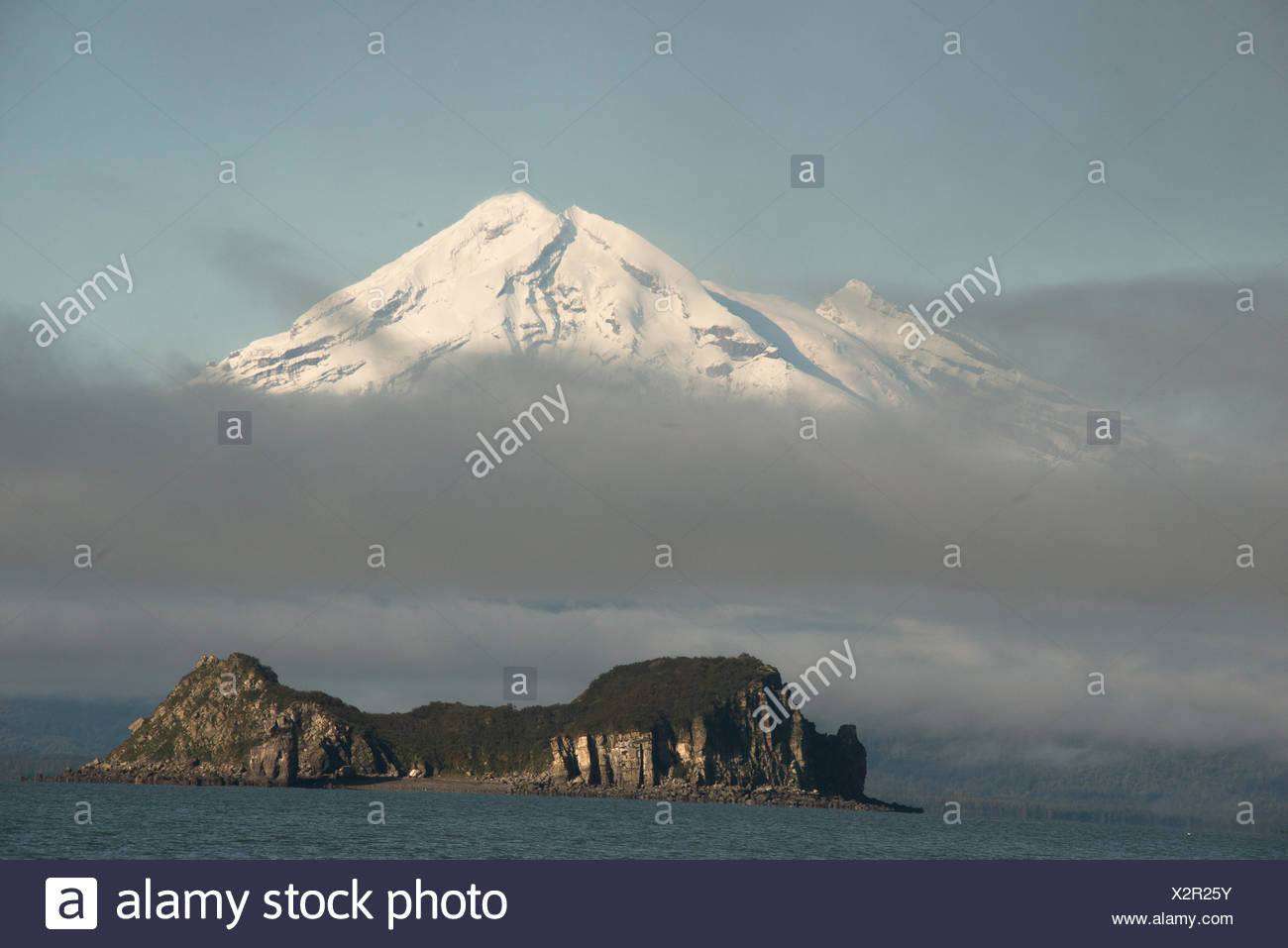 Mount Redoubt and Duck Island in Lake Clark National Park. - Stock Image