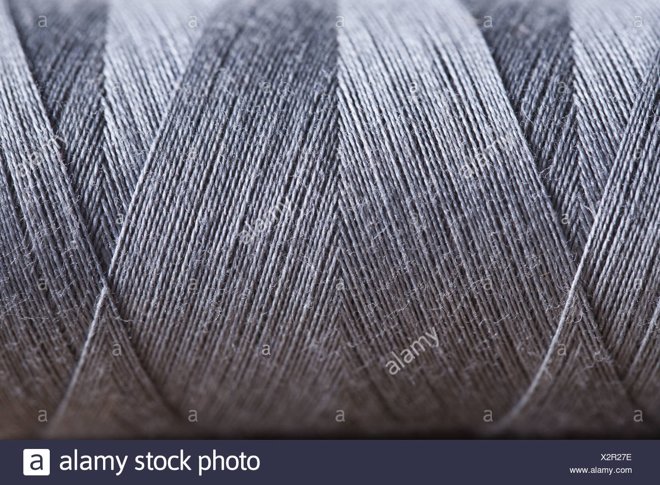 Close-up view of silver string spool - Stock Image