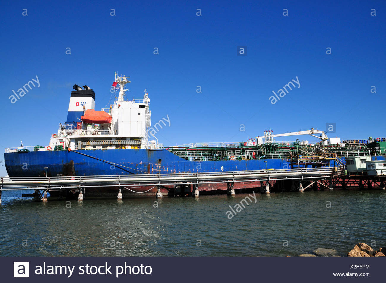 Israel, Haifa, Kishon Harbour. Oil Tanker supplies crude oil to the refinery - Stock Image