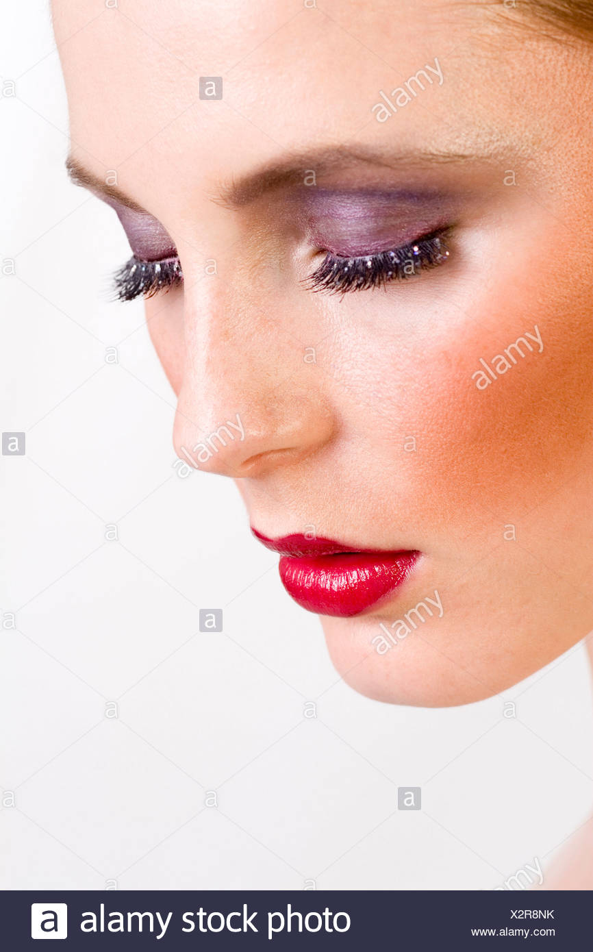 young woman with violett eye shadow - Stock Image