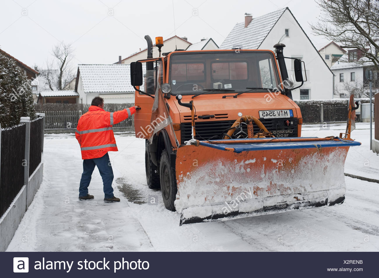 Snowplow with driver - Stock Image
