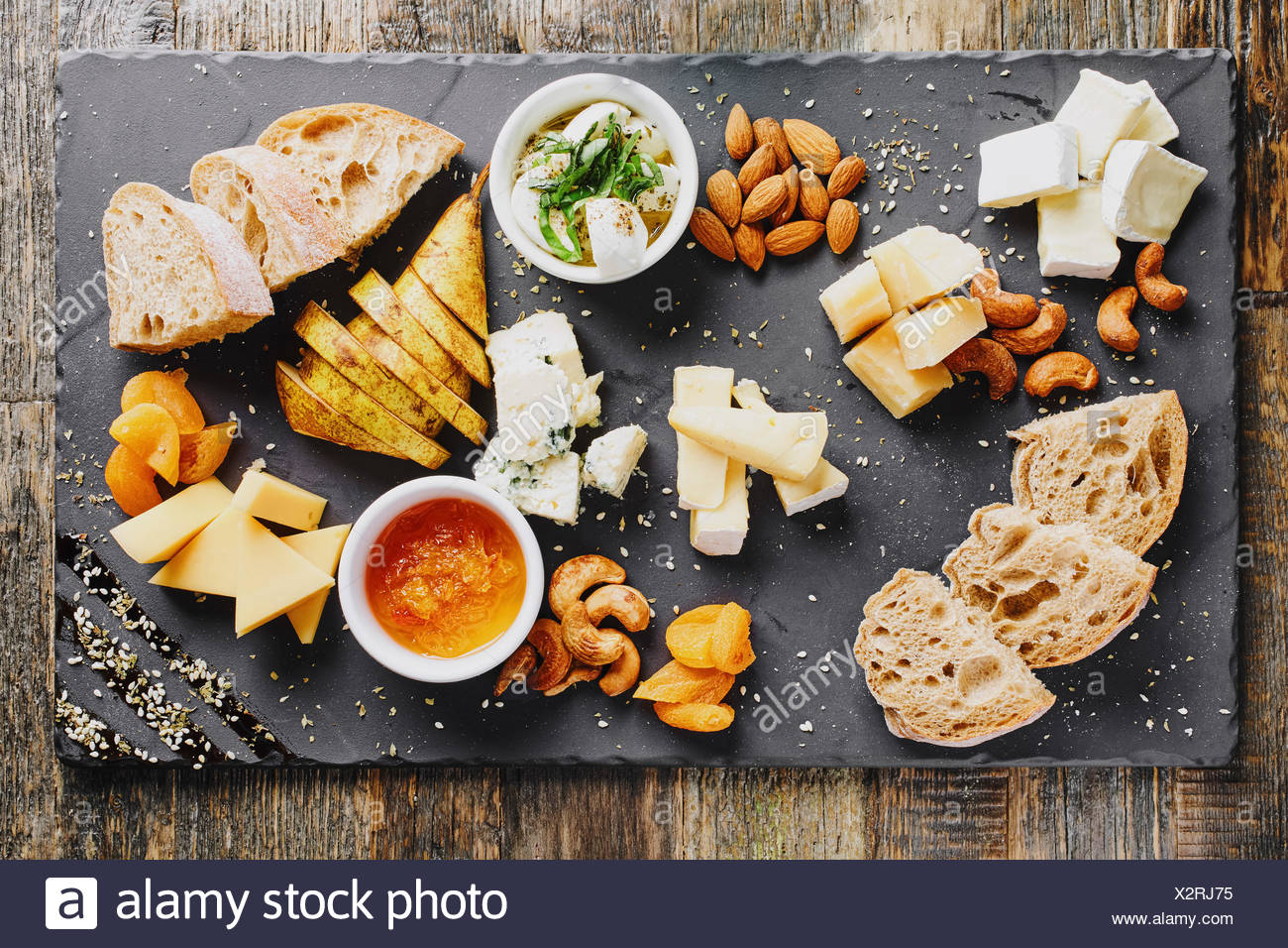 Elevated view of cheese platter served with ciabatta bread - Stock Image