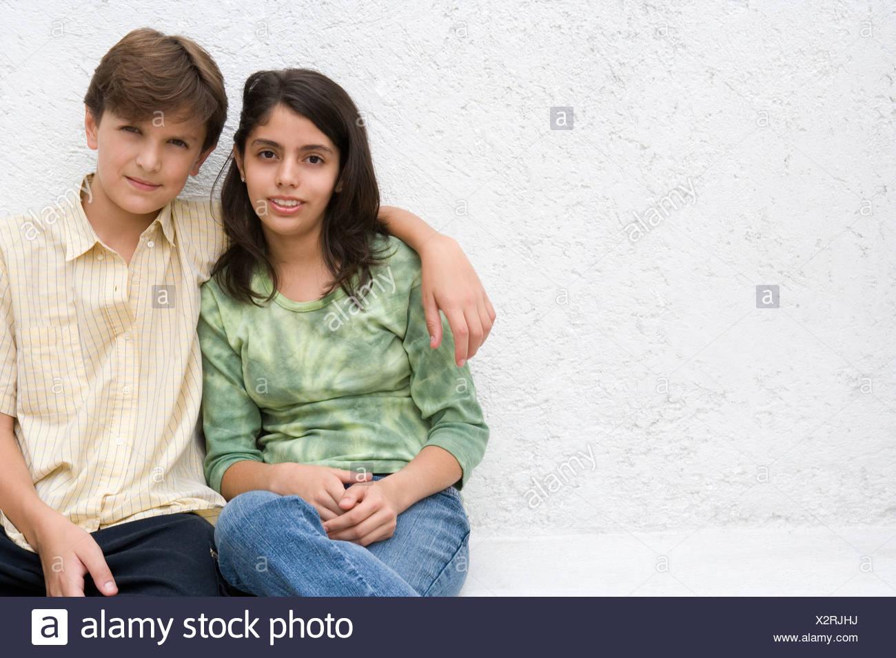siblings hugging stock photo 277114702 alamy
