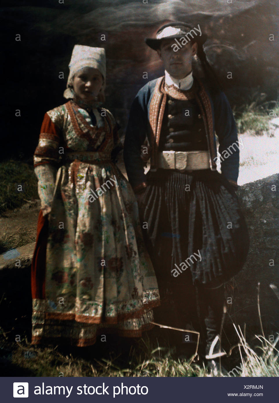 A man and a woman pose in award-winning 1830's costumes. - Stock Image
