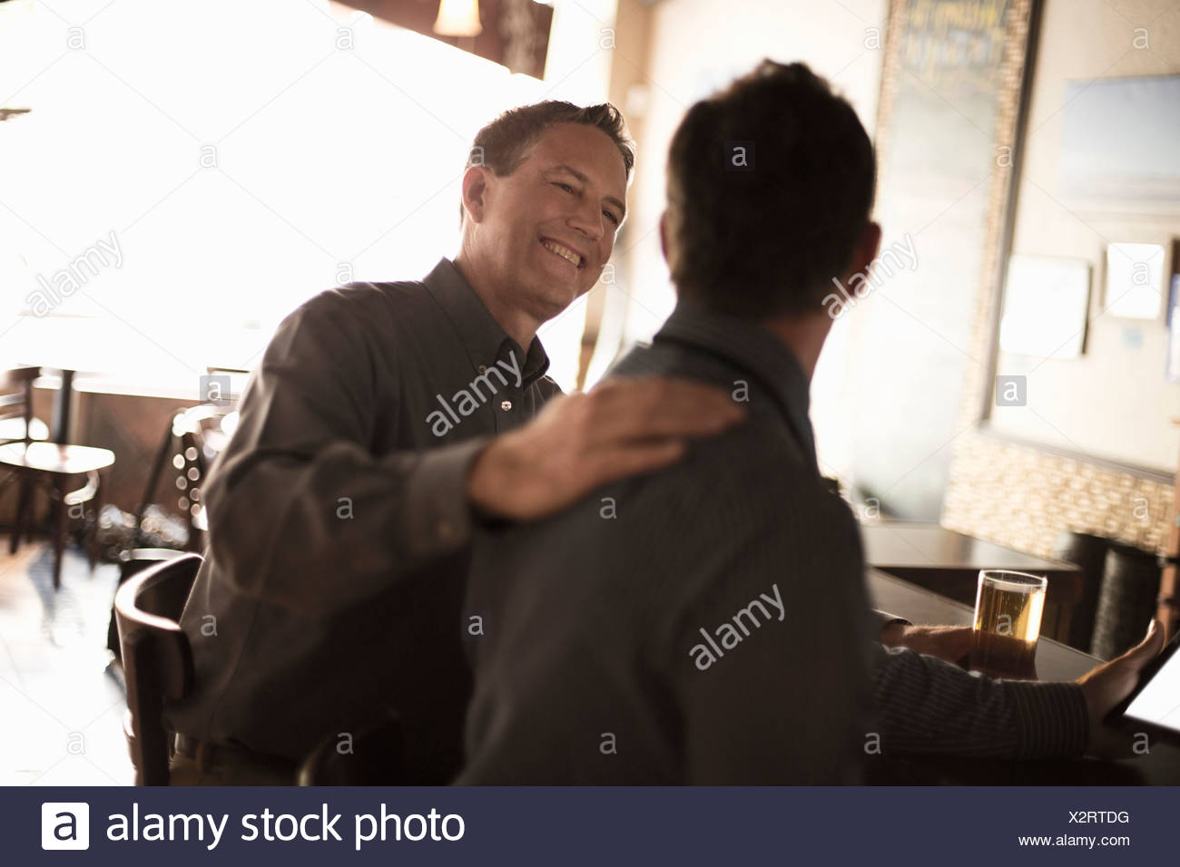 Two business partners in wine bar - Stock Image