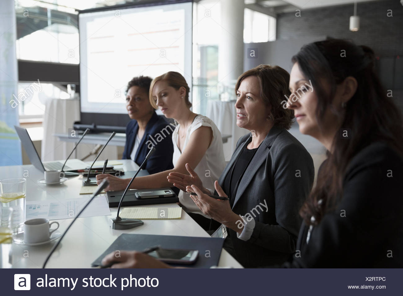 Businesswoman talking on conference panel - Stock Image