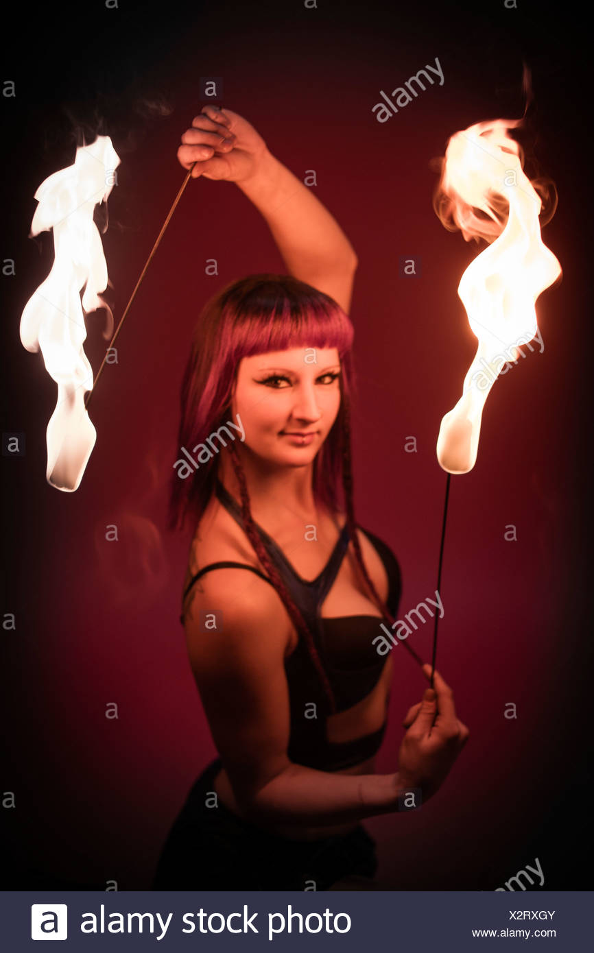 Fire dancer performing - Stock Image