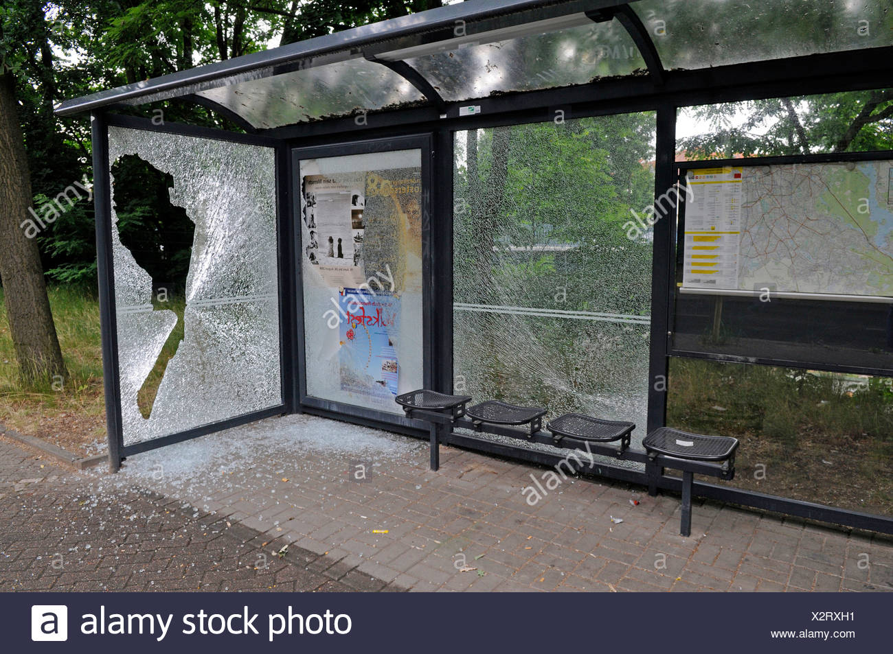 Vandalism on a bus stop Stock Photo