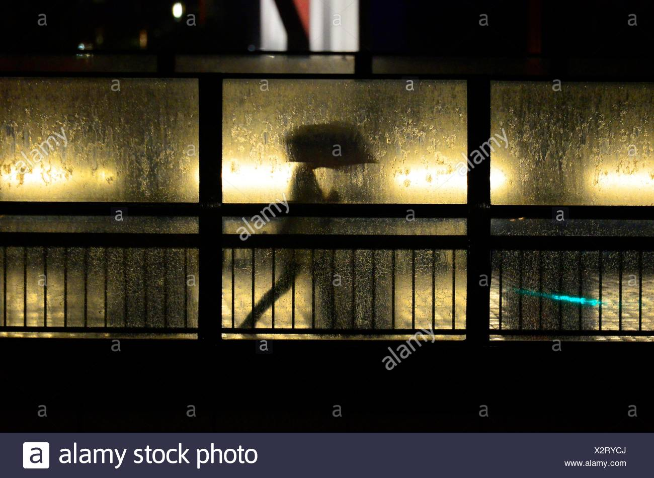 Silhouette of man holding umbrella, Tokyo, Japan,Asia. - Stock Image