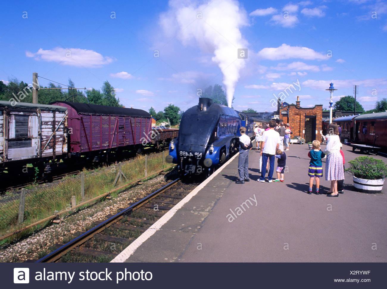 Rothley Leicestershire Sir Nigel Gressley people steam train engine platform blue streamline transport vintage England UK - Stock Image