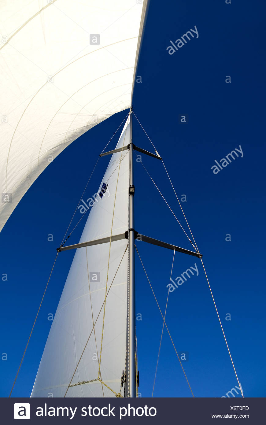 Sailing against a blue sky - Stock Image