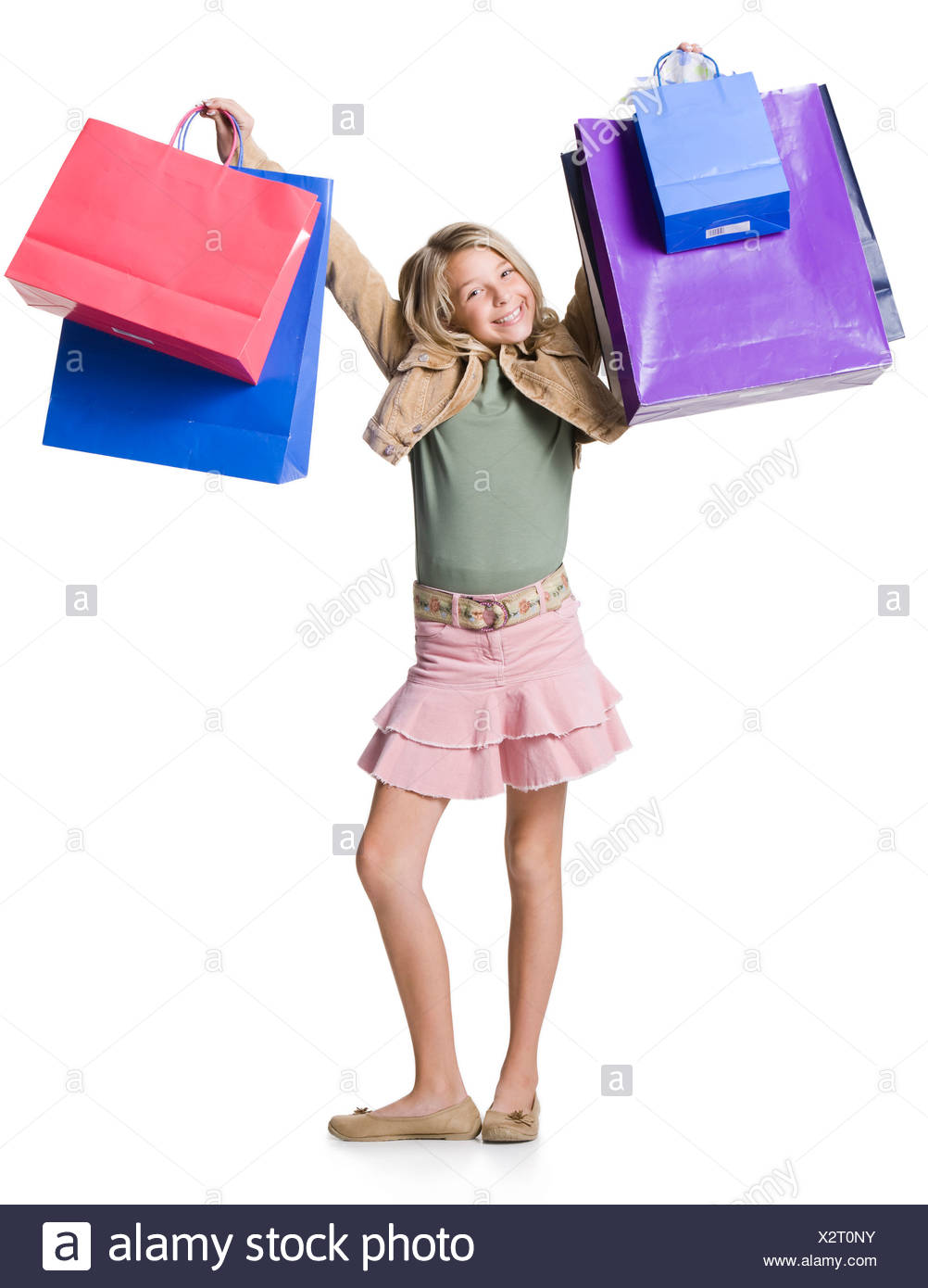 Girl running with shopping bags - Stock Image