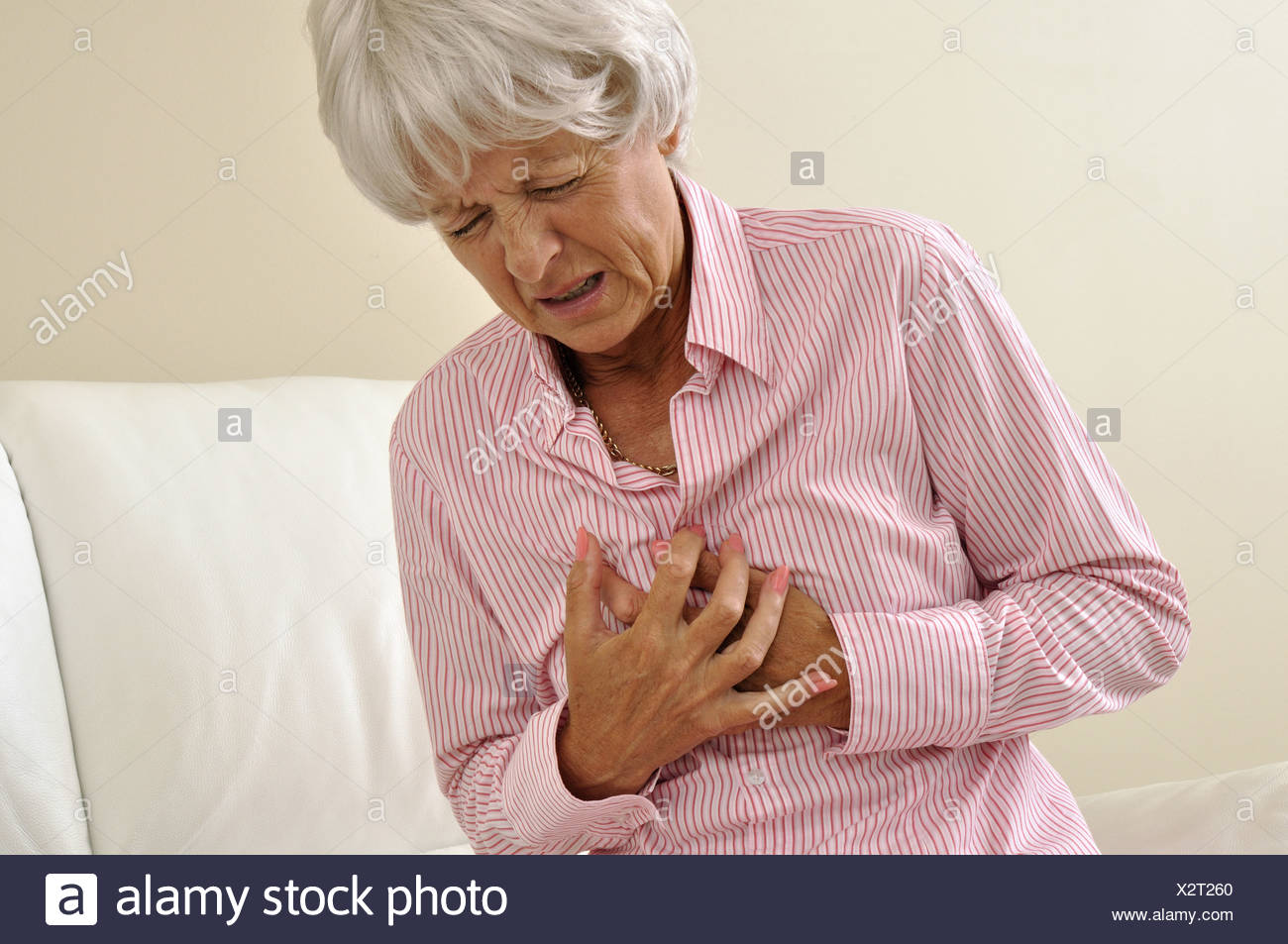 Indoors Indoor Woman Senior Mature Angina Heart Pain Old Sick Myocardial infarction Heart attack - Stock Image