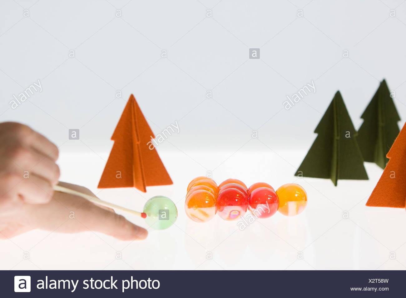 Woman playing pool with Christmas Ornaments - Stock Image