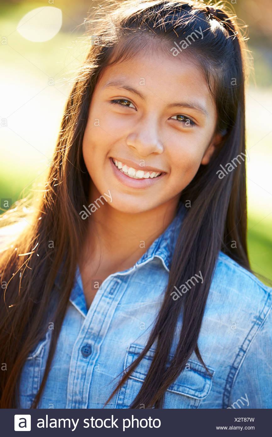 Portrait Of Hispanic Girl In Countryside - Stock Image