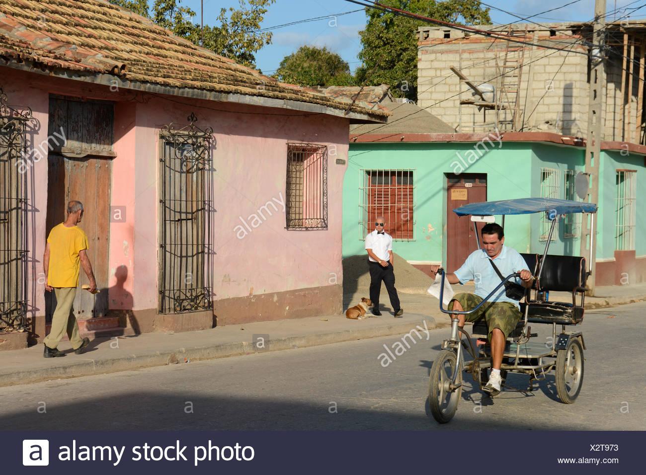 Sreet scene with pedicab, Trinidad,  Cuba - Stock Image