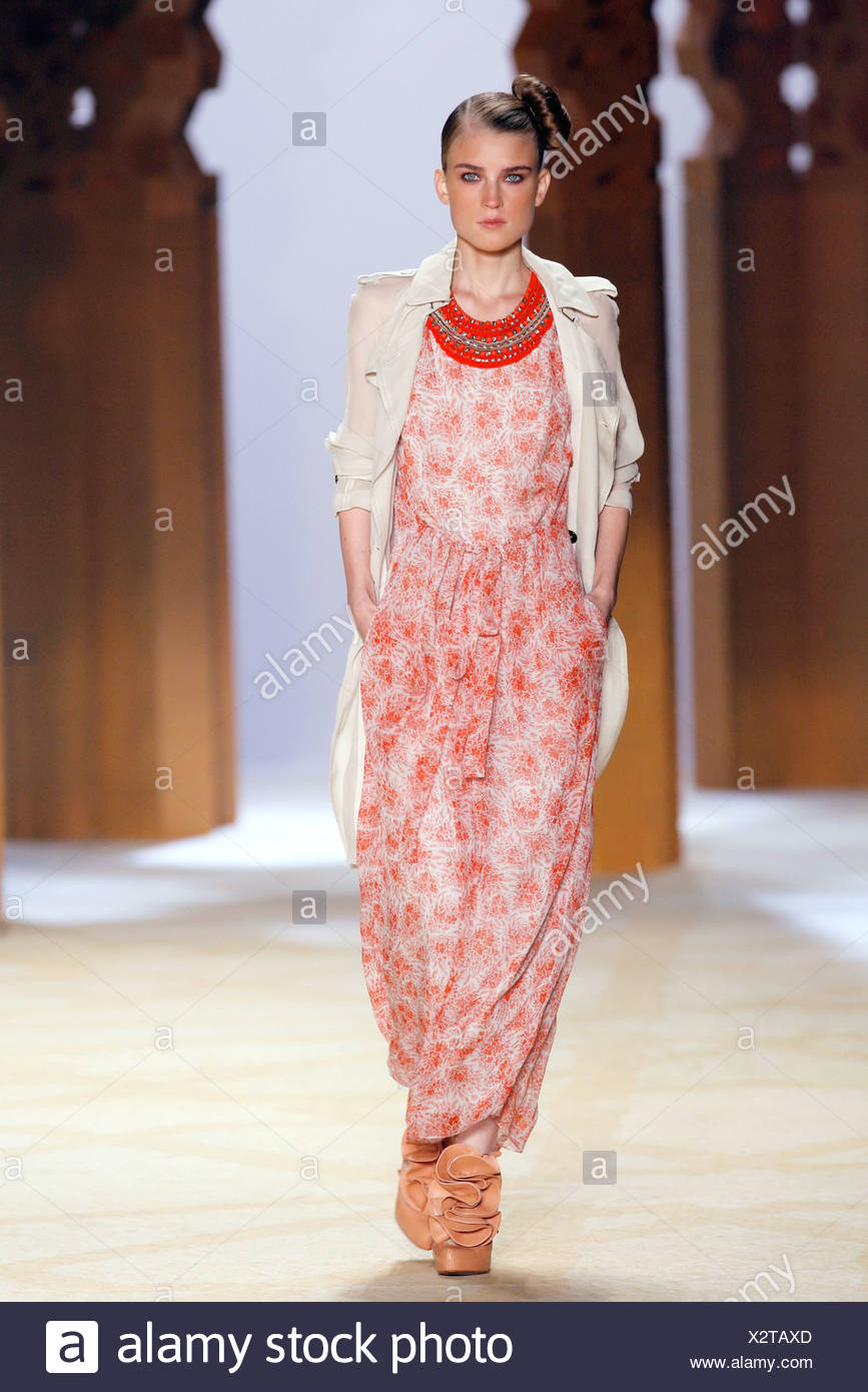 0af632f966 Phillip Lim New York Ready to Wear Spring Summer Model wearing a white and red  patterned baggy jumpsuit an embroidered