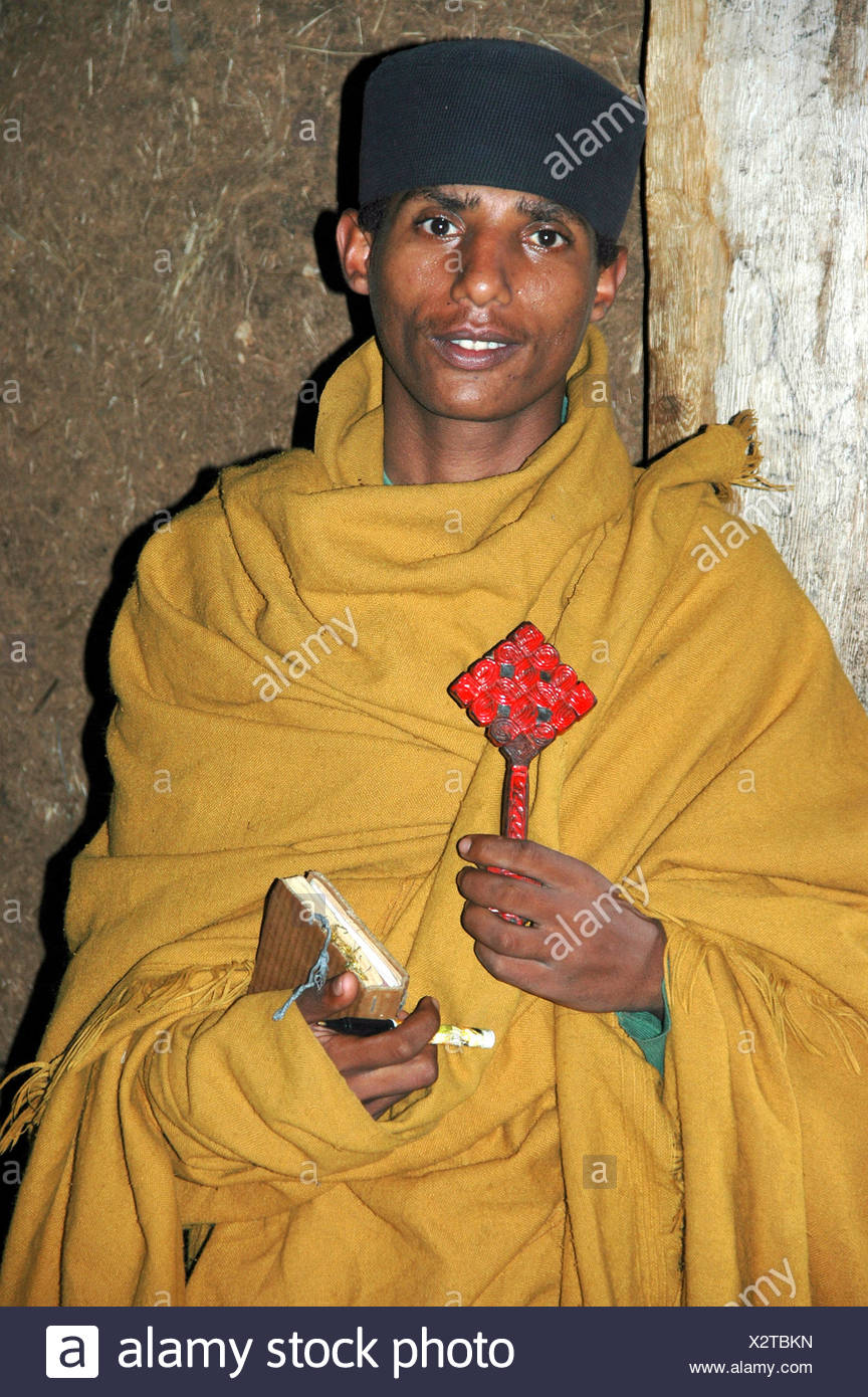 Dean with cross and bible, Ukra Kidane Mekret Abbey, Tana Lake, near Bahir Dar, Ethiopia, Africa - Stock Image