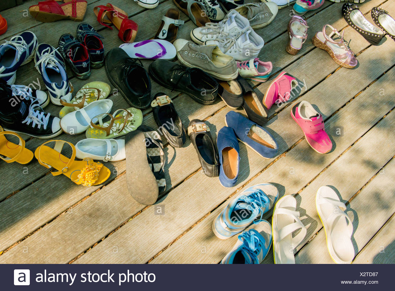Large group of shoes on wooden planks Stock Photo
