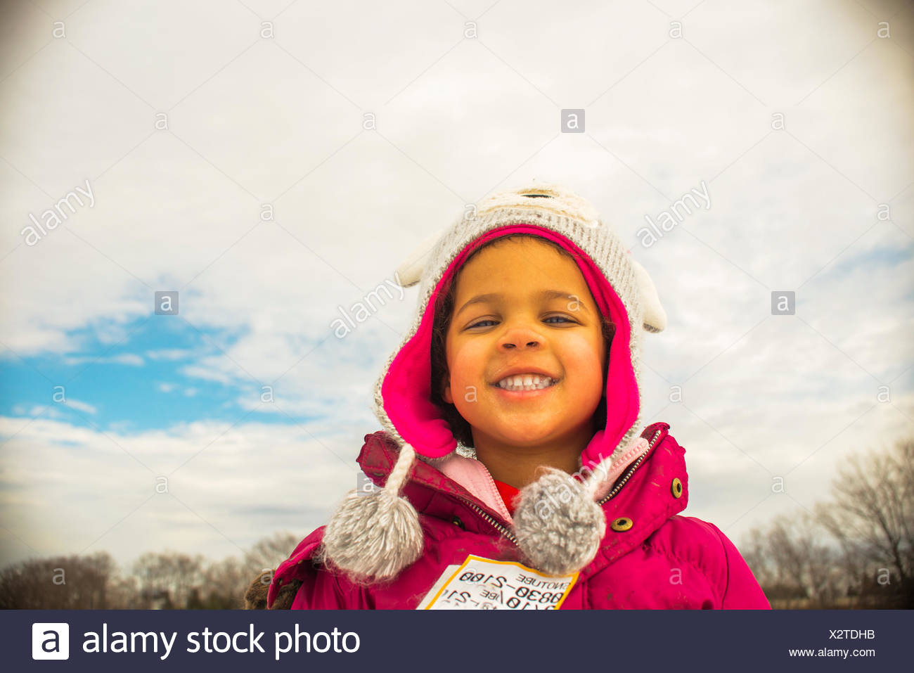 Portrait of girl in knit hat with eyes closed - Stock Image