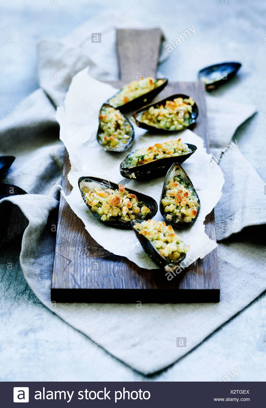 Plate of baked mussels - Stock Image