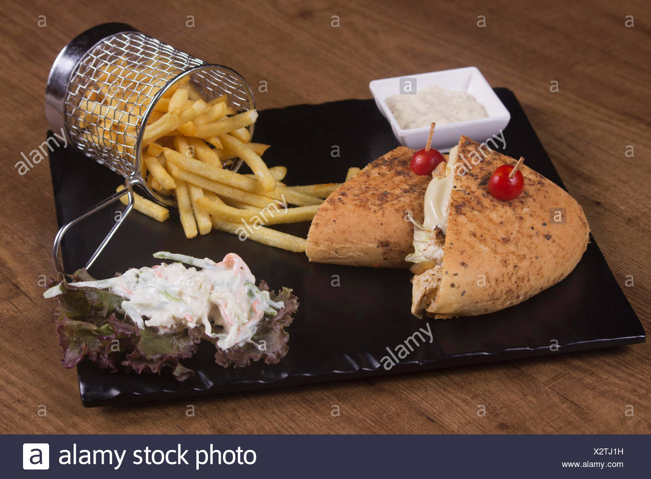 Cajun spiced cottage cheese sandwich with potato fries and sauce - Stock Image