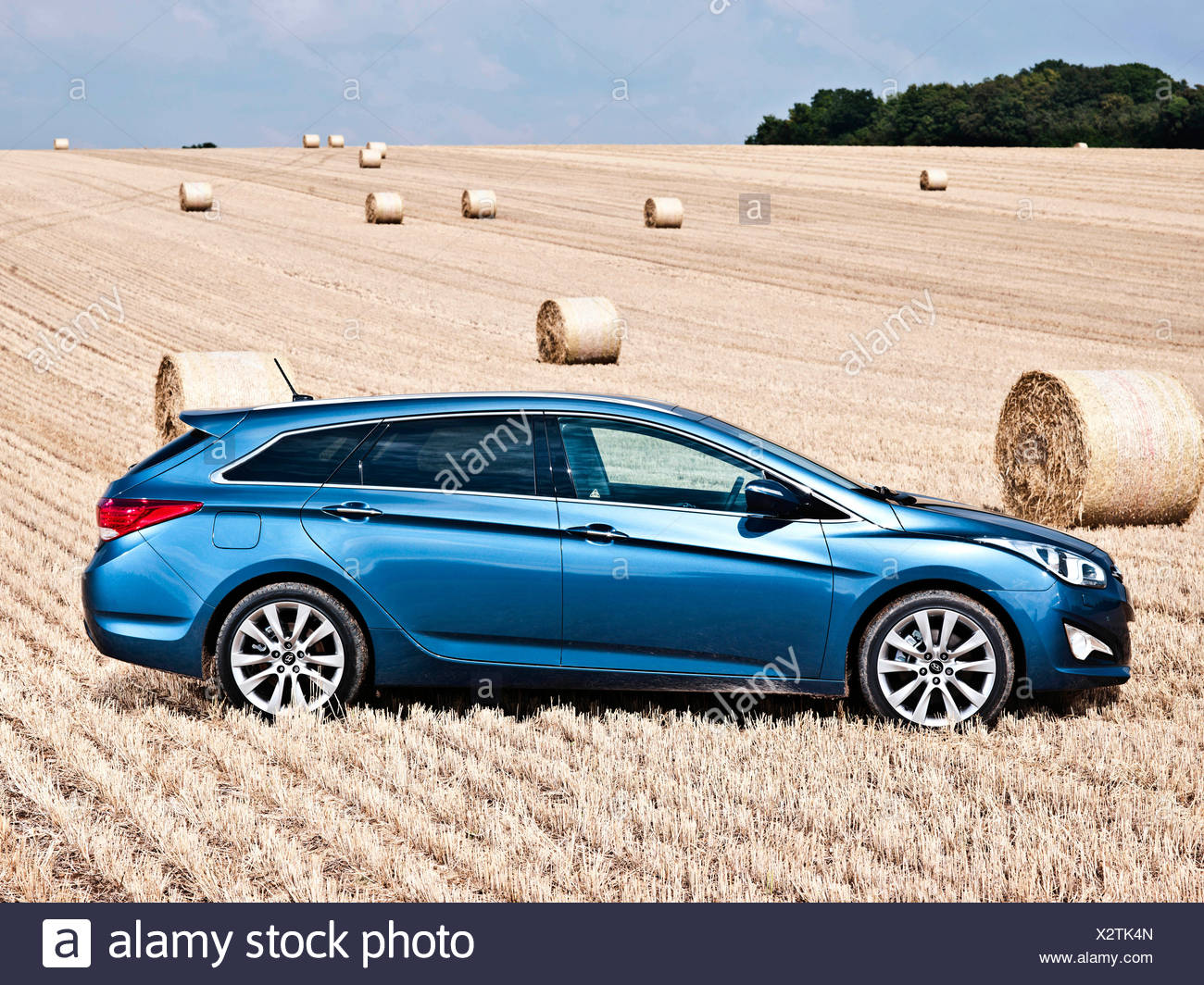 Hyundai i40, large family car, in a hayfield, Southampton, UK, 20 08 2012 - Stock Image