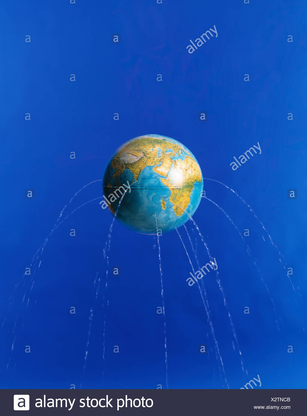 Planet earth with water leaking from it - Stock Image